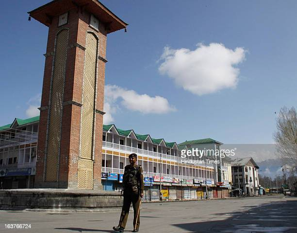 Paramilitary soldier stands guard during a curfew on March 15 2013 on Srinagar India Curfew continued for the second consecutive day in Srinagar...