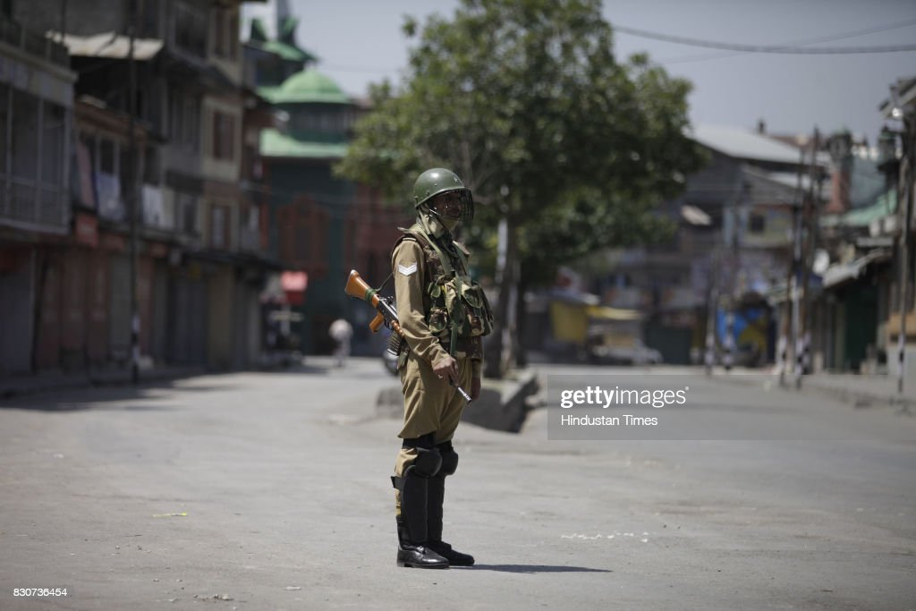 A paramilitary soldier stands guard during restrictions in a downtown area on August 11, 2017 in Srinagar, India. Authorities imposed restrictions in parts of downtown Srinagar as separatists called a shutdown in Kashmir against a petition in the Supreme Court of India seeking abrogation of Article 35-A, which confers special rights on Jammu and Kashmir's permanent residents. The petition was filed in 2014 by a Non-Government Organisation (NGO) 'We The Citizens' seeking that the article be struck down. The petition alleges that the state government, under the guise of the article, discriminates against non-residents in matters of government jobs or buying property, according to news reports.