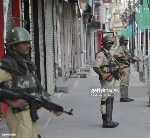 Paramilitary soldiers stand guard during curfew in Lal Chowk area on July 8 2017 in Srinagar India Authorities imposed curfew in some parts of...