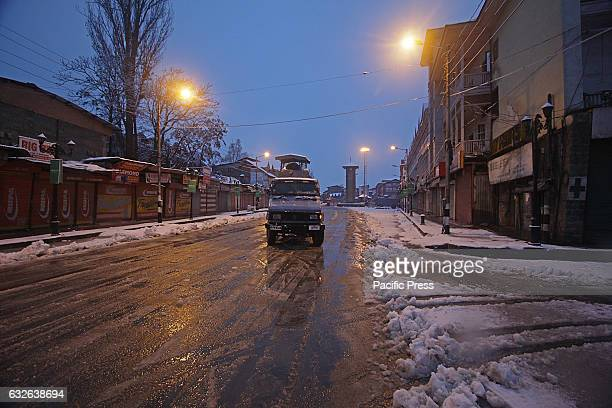 Paramilitary vehicle moves early morning after the fresh snowfall in Srinagar the summer capital of Indian controlled Kashmir on January 25...