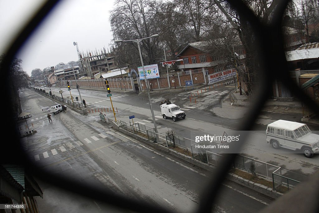 Paramilitary vehicles patrolling during curfew in entire valley to thwart the 'Eid-Gah challo' call given by separatist's parties on February 15, 2013 in Srinagar, India. Most of the valley is reeling under strict curfew and all roads coming to summer capital has been blocked with concertina wires and road blockades.