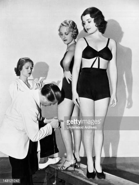 A Paramount director measuring a girl's leg for film role Hollywood California July 24 1933 LeRoy Prinz the dance director for Paramount insists upon...