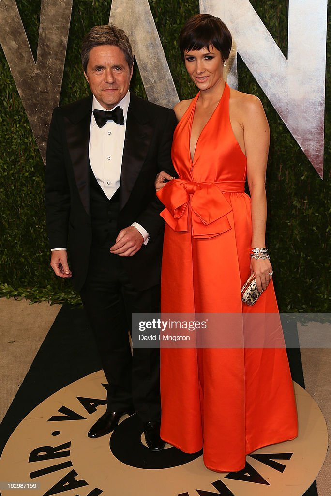 Paramount Pictures chairman and CEO Brad Grey (L) and wife Cassandra Huysentuyt attend the 2013 Vanity Fair Oscar Party at the Sunset Tower Hotel on February 24, 2013 in West Hollywood, California.