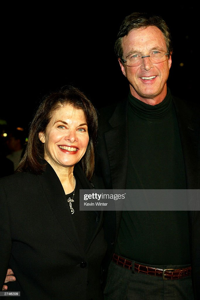 Paramount's Sherry Lansing and writer Michael Crichton pose at the premiere of 'Timeline' at the National Theatre on November 19, 2003 in Los Angeles, California.