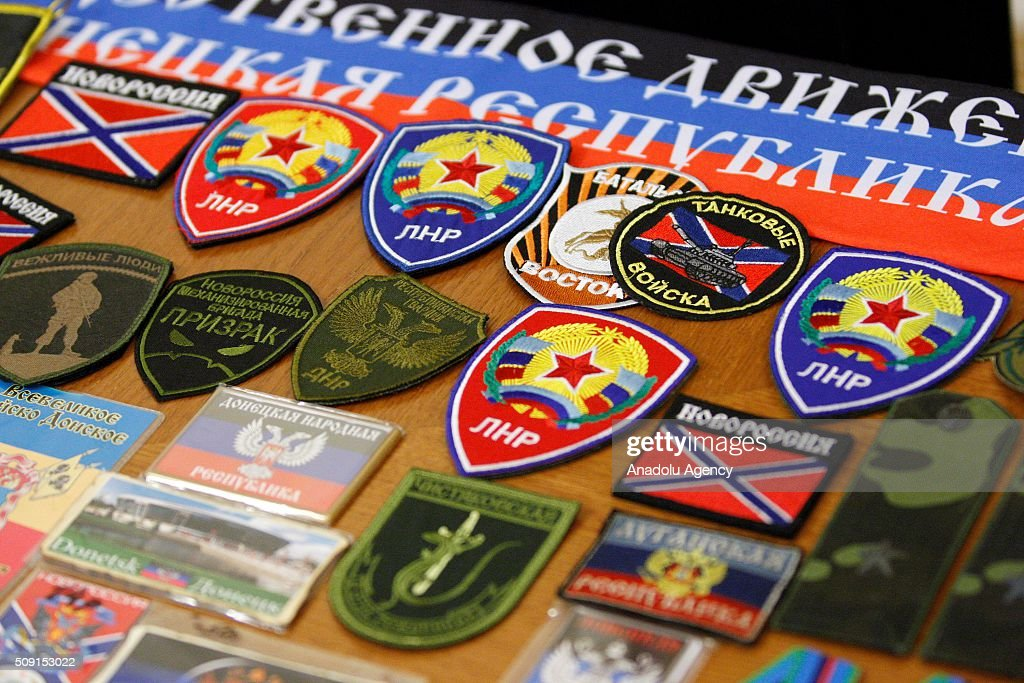 Paraphernalia, chevrons and symbols of 'LPR' and 'DPR' are being displayed during a press conference of Head of the Security Service of Ukraine Vasyl Hrytsak, where was presented evidence of the involvement of staff officers of the Russian Federation to cooperation with pro-Russian separatists on the East of the country in Kiev, Ukraine on February 09, 2016. Security Service of Ukraine detained two Russian officers - Captain Sergei Kutsenko and Major Andrew Kornyak, which are part of the Joint center for control and coordination of the ceasefire and stabilize the line dividing the sides, Gritsenko said. During the arrest they seized chevrons different samples, 14 manuals on military affairs with the stamp of 'limited use' and other documents.