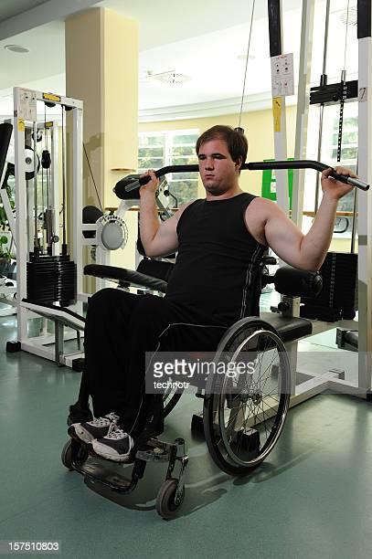 Paraplegic on wheelchair exercising
