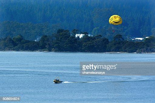 Parasailing over lake Rotorua New Zealand : Stock Photo