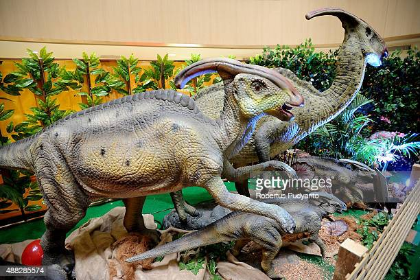 Parasaurolophus replicas are displayed in the Dinosaur Adventure and Learning Experience Park at Tunjungan Plaza on September 15 2015 in Surabaya...