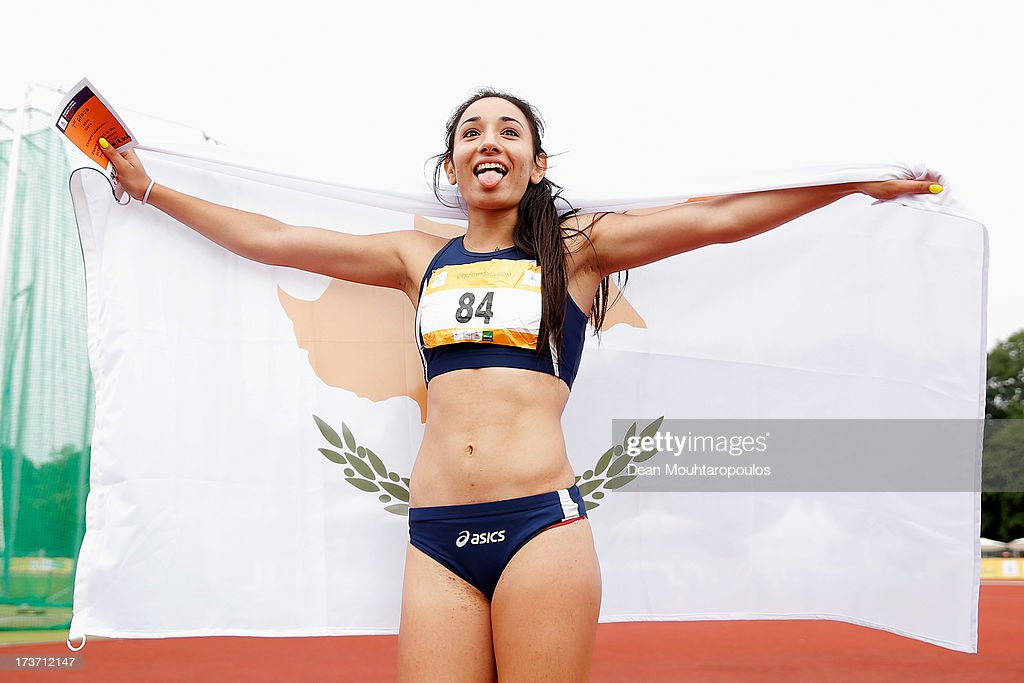 Paraskevi Andreou (#84) of Cyprus celebrates winning Gold in the Girls 100m during the European Youth Olympic Festival held at the Athletics Track Maarschalkersweerd on July 16, 2013 in Utrecht, Netherlands.