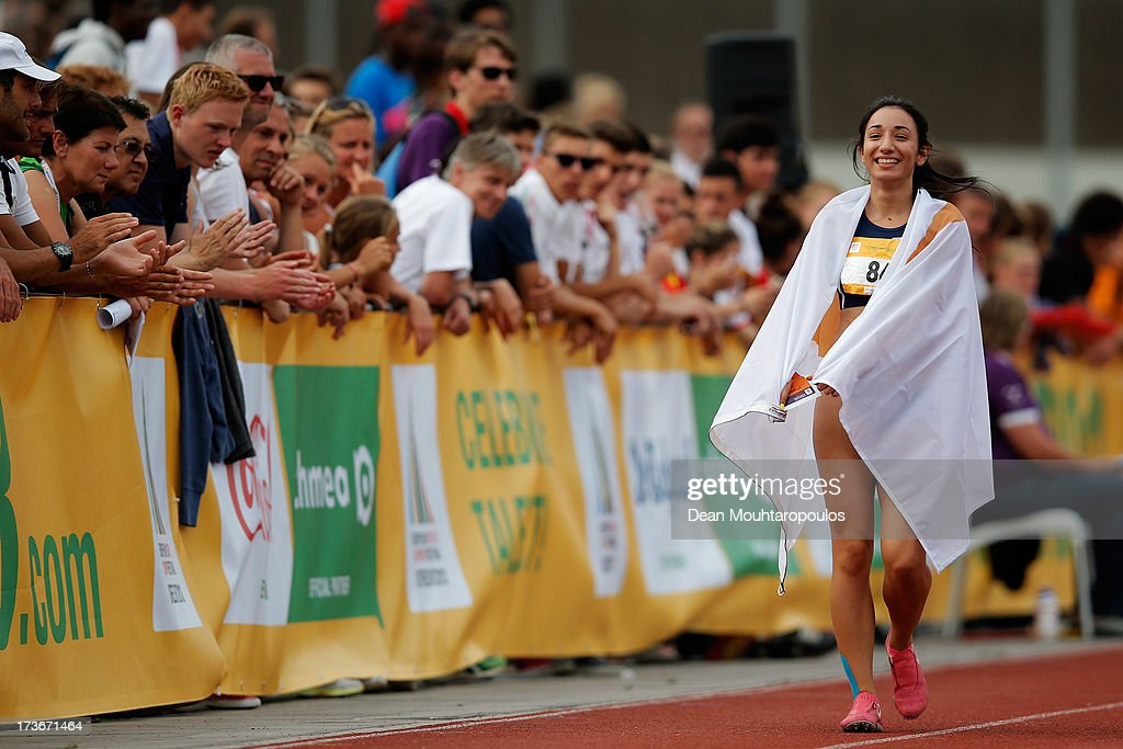 Paraskevi Andreou (#84) of Cyprus celebrates winning the Girls 100m during the European Youth Olympic Festival held at the Athletics Track Maarschalkersweerd on July 16, 2013 in Utrecht, Netherlands.