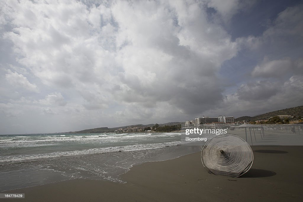 A parasol lies disused on the beach in Limassol, Cyprus, on Wednesday, March 27, 2013. The ECB said on March 25 it won't stop the Cypriot central bank from providing the island's banking sector with emergency funding. Photographer: Simon Dawson/Bloomberg via Getty Images