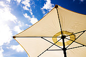 Photograph of a patio Parasol from a low point of view.