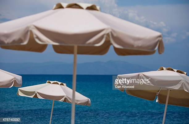 Parasols line the beach front on June 03 2015 in Kos Greece The Island has recently seen a drop in tourist numbers which has been attributed to...