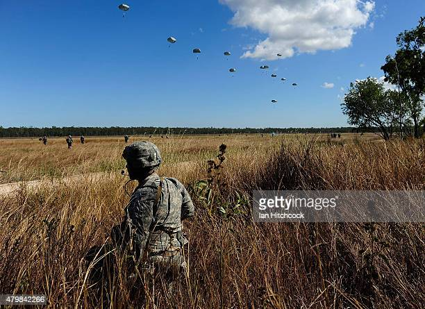Paratrooper from 4/25th Infantry Division looks on as other members of his unit make a jump from a C17 Globemaster as part of exercise Talisman Sabre...