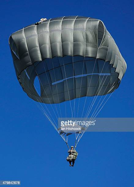 Paratrooper from the 4/25th Infantry Division decends to the drop zone after making a jump from a C17 Globemaster as part of exercise Talisman Sabre...