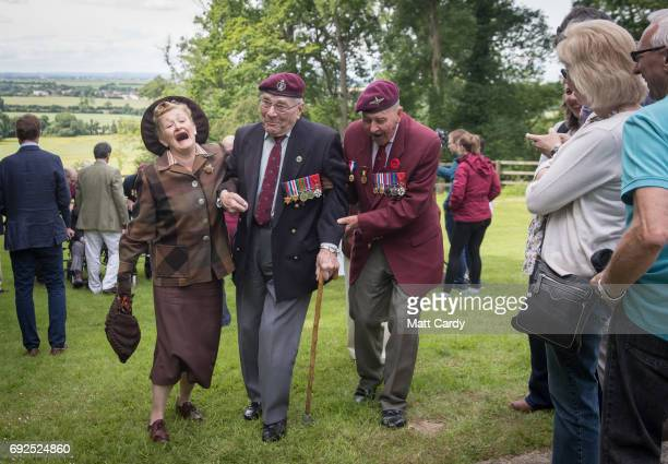 Paratrooper Gordon Newton who was in the 9th battalion and Geoff Paterson 9th Para share a joke as they commemorate the 73rd anniversary of the DDay...