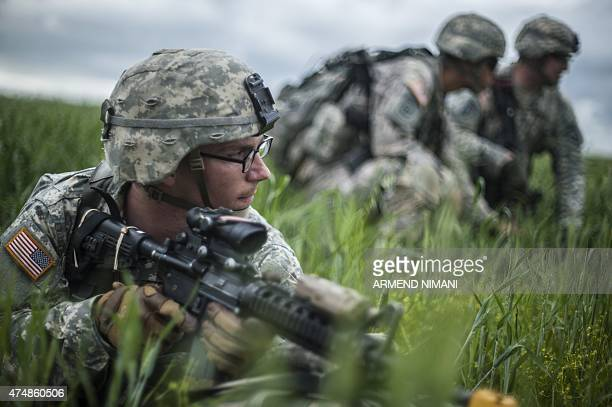 A US paratrooper of the Army's 4th 25 Infantry Brigade Combat Team part of the NATOled peacekeeping mission in Kosovo takes part in a military drill...