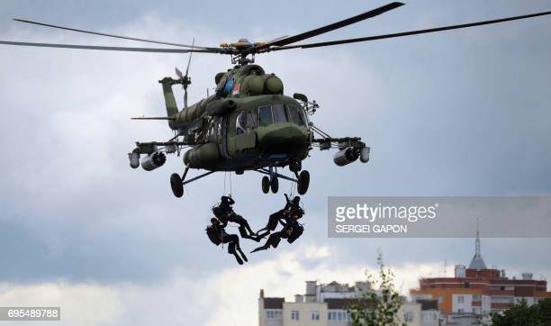 Paratroopers demonstrate their skills during the Slav Brotherhood International military exercises in the town of Brest some 370 kms southwest of...