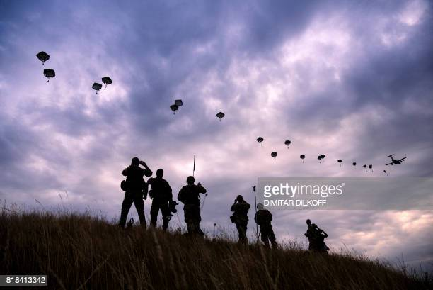 TOPSHOT NATO paratroopers drop out of a US Air Force Hercules during the 'Swift Response 17' joint airborn military exercise at Bezmer airfield near...