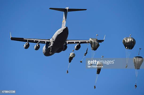 Paratroopers from the 4/25th Infantry Division make a jump from a C17 Globemaster as part of exercise Talisman Sabre on July 8 2015 in Rockhampton...