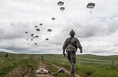 US paratroopers of the Army's 4th 25 Infantry Brigade Combat Team part of the NATOled peacekeeping mission in Kosovo jump with parachute during a...