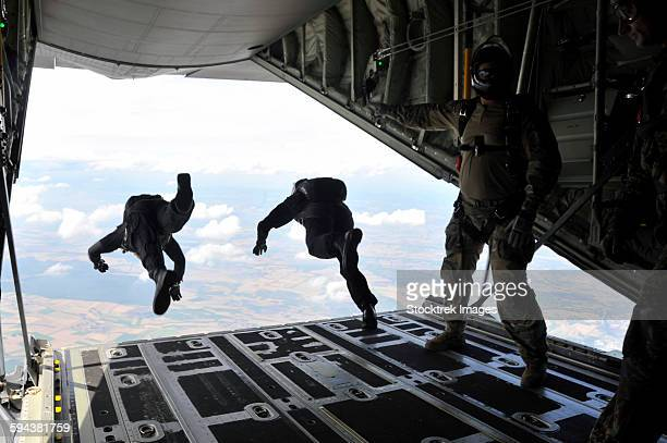 Paratroopers with the Spanish military jump from a C-130J Super Hercules.