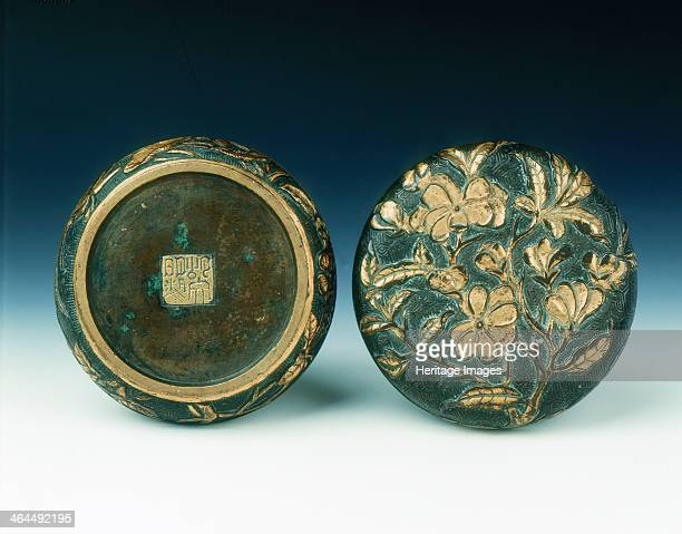 Parcel gilt bronze incense box of magnolia with mark of Hu Wenming Wanli period Ming dynasty China 15731620 A bronze circular incense box The cover...