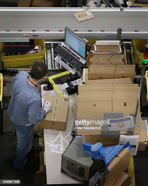 Parcels are prepared for dispatch at Amazon's warehouse on December 5 2014 in Hemel Hempstead England In the lead up to Christmas Amazon is...