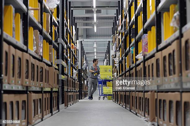 Parcels are processed and prepared for dispatch at Amazon's fulfillment centre on November 15 2016 in Peterborough England In the lead up to...