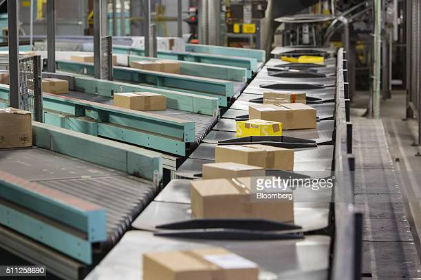 Parcels move along conveyors at a DHL parcel center operated by Deutsche Post AG in Saulheim Germany on Thursday Feb 18 2016 Deutsche Post is 'not...