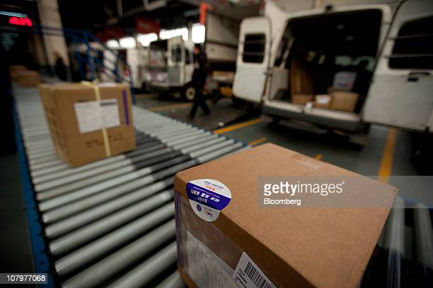Parcels move down the line at a FedEx Corp station in Shanghai China on Tuesday Jan 11 2011 FedEx's AsiaPacific hub is in Guangzhou Photographer...