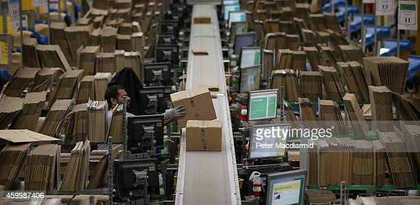 Parcels move through Amazon's warehouse on December 5 2014 in Hemel Hempstead England In the lead up to Christmas Amazon is experiencing the busiest...