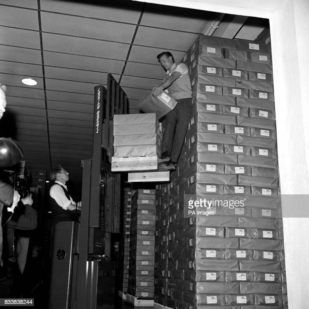 Parcels of paperbacked copies of 'Lady Chatterley's Lover' by DH Lawrence are seen being stacked on a forklift truck at the Harmondsworth Middlesex...