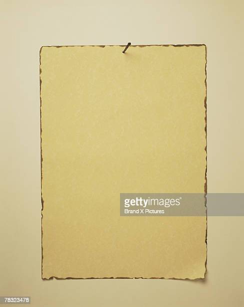Parchment paper with rusty nail