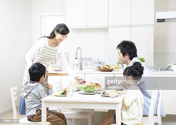Parent and child eating breakfast