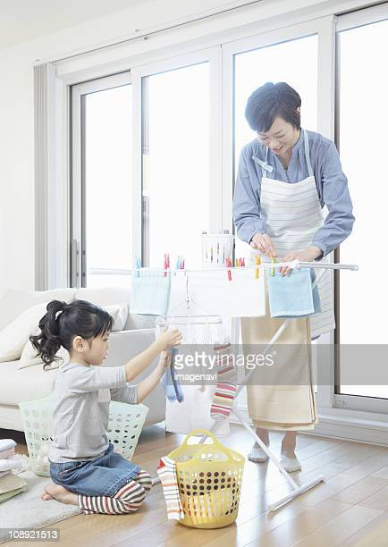 Parent and child hanging out the laundry