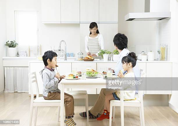 Parent and child having a meal