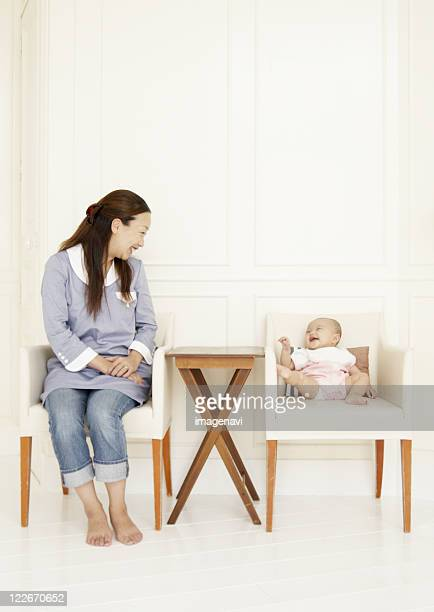 Parent and child sitting on chair