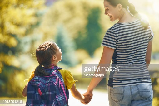 Parent and pupil go to school : Stock Photo
