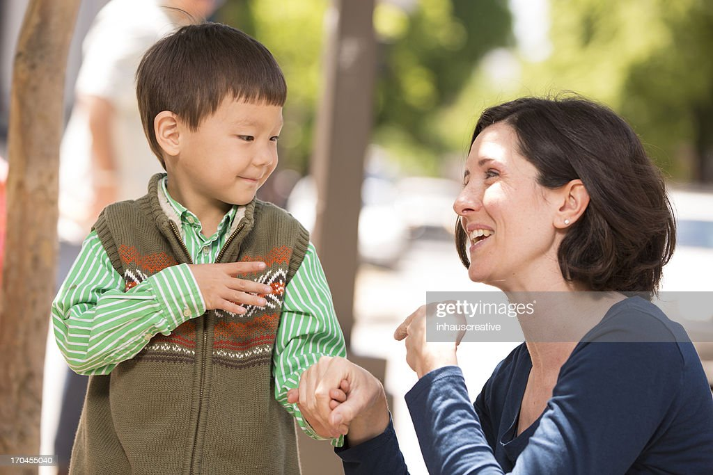 Parent communicating with sign language