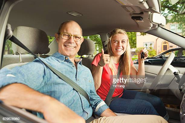 Parent Driving Instructor and Happy Teenage Student Driver in Car