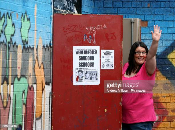 Parent Jackie Weir from Glasgow Save Our Schools Campaign waves from the fire exit door of the school gym at St Gregory's Primary Glasgow
