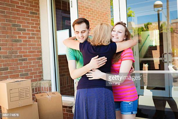 Parent Saying Goodbye to Students Moving into University Dormitory