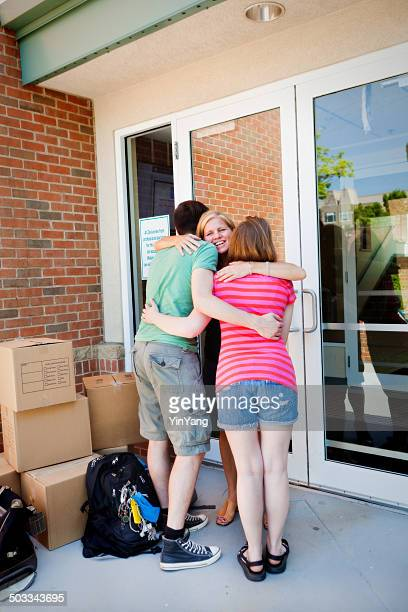 Parent Saying Goodbye to Students Moving into University Dormitory Vertical