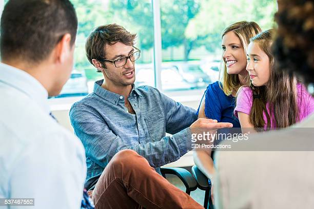 Parent teacher meeting with family