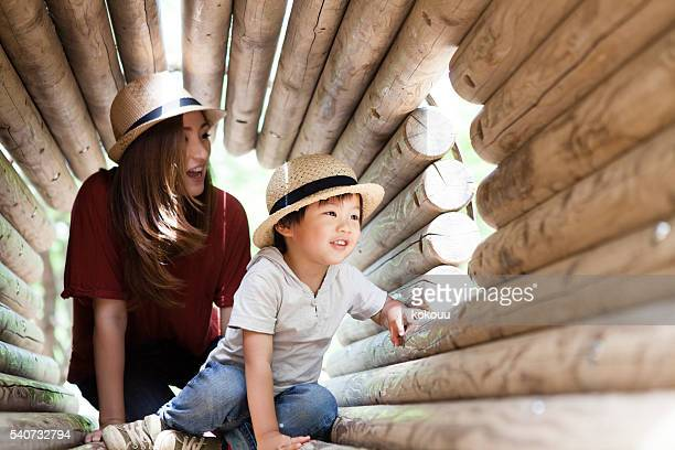 Parent-child playing with fun in the tunnel