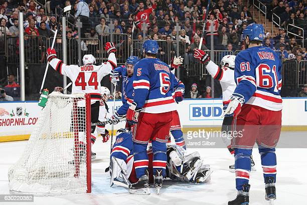 Parenteau and Miles Wood of the New Jersey Devils celebrate after scoring a goal in the second period against Henrik Lundqvist of the New York...