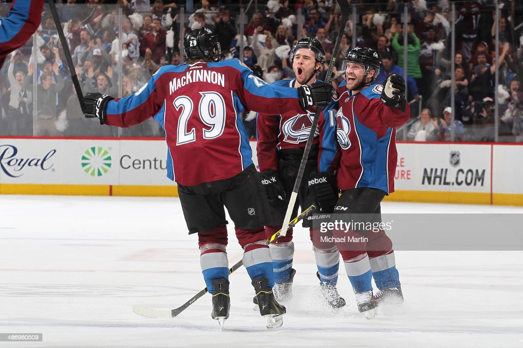 PA Parenteau #15 of the Colorado Avalanche celebrates his tying goal late in the third period with teammates <a gi-track='captionPersonalityLinkClicked' href=/galleries/search?phrase=Nathan+MacKinnon&family=editorial&specificpeople=8610127 ng-click='$event.stopPropagation()'>Nathan MacKinnon</a> #29 and Andre Benoit #61 against the Minnesota Wild in Game Five of the First Round of the 2014 Stanley Cup Playoffs at the Pepsi Center on April 26, 2014 in Denver, Colorado.