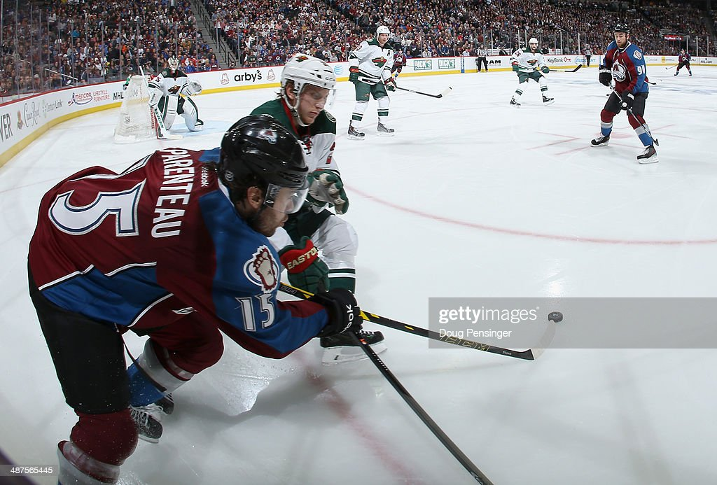 P.A. Parenteau #15 of the Colorado Avalanche controls the puck against the Minnesota Wild Game Seven of the First Round of the 2014 NHL Stanley Cup Playoffs at Pepsi Center on April 30, 2014 in Denver, Colorado. The Wild defeated the Avalanche in overtime 5-4 to win the series.