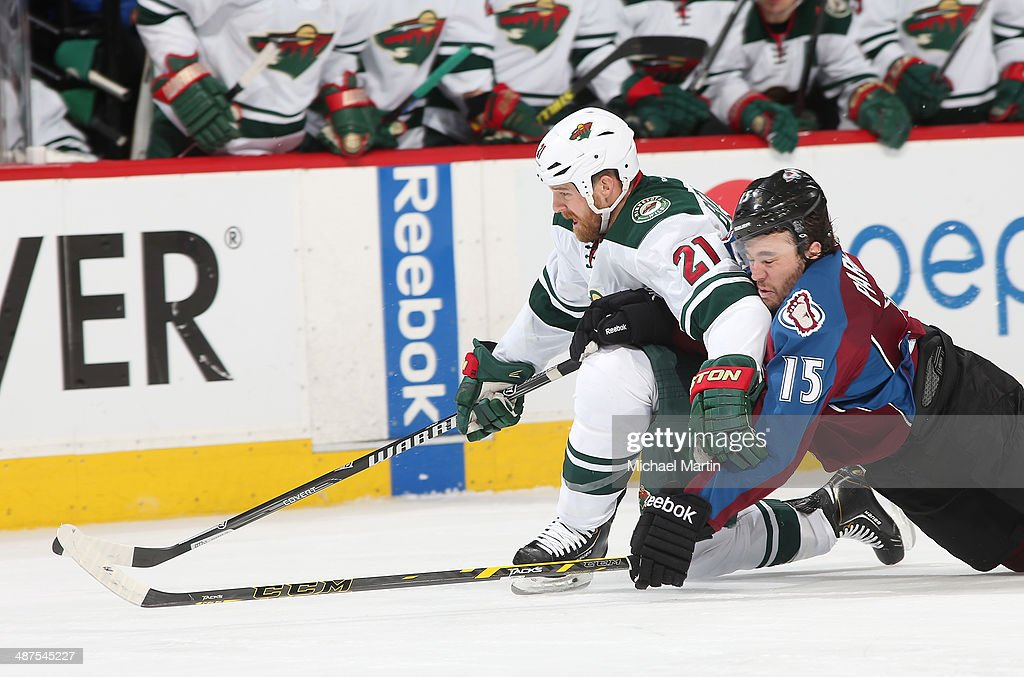 PA Parenteau #15 of the Colorado Avalanche falls onto Kyle Brodziak #21 of the Minnesota Wild while playing for the puck in Game Seven of the First Round of the 2014 Stanley Cup Playoffs at the Pepsi Center on April 30, 2014 in Denver, Colorado.